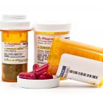 Bottle of prescription medicine pills for a medical patient