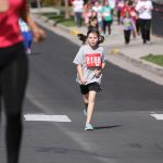 young girl running in race